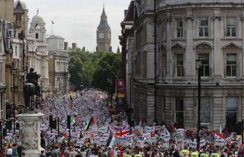Hundreds of demonstrators march up Whitehall as they protest against Israel's military action in Gaza, in central London